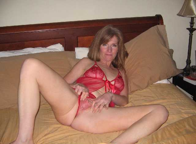 Mature milf playing with her nipples
