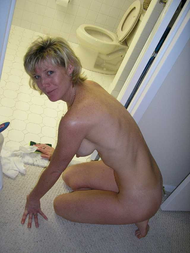 Milf wife topless cleaning the house
